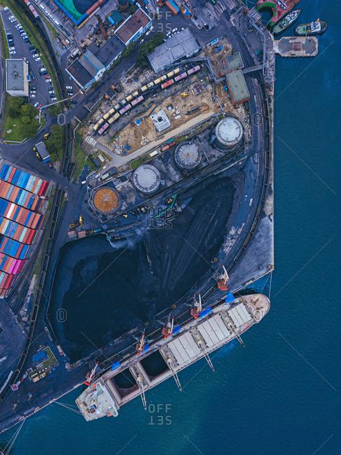 Russia- Primorsky Krai- Vladivostok- Aerial view of industrial ship moored in coal loading dock