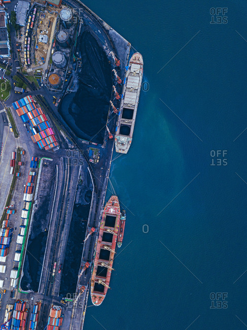 Russia- Primorsky Krai- Vladivostok- Aerial view of industrial ships moored in coal loading dock