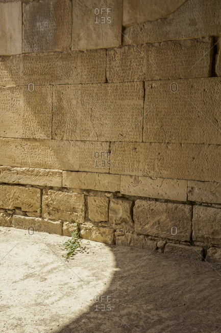 June 7, 2013: Scripts carved on stone wall at Odeon Of Gortyn- Crete- Greece