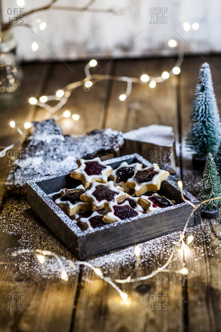 Christmas lights and tray of star shaped jam cookies