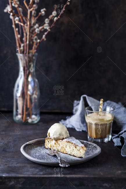 Slice of Spanish Gato de Almendras cake and glass of iced coffee