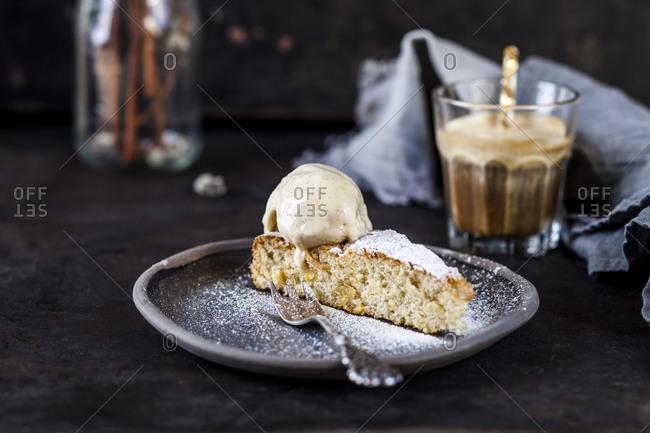 Slice of SpanishGatodeAlmendrascake and glass of iced coffee