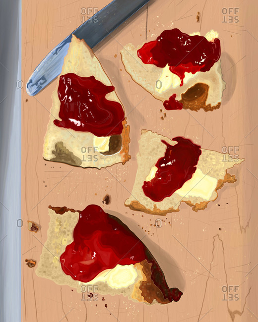 Sourdough bread with butter and jelly on cutting board