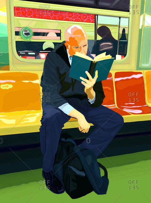 A bald man commuting on a subway train reading a book