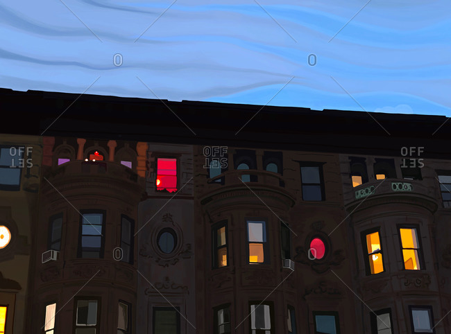 A row of brownstone rowhouses at twilight with multicolored glowing windows