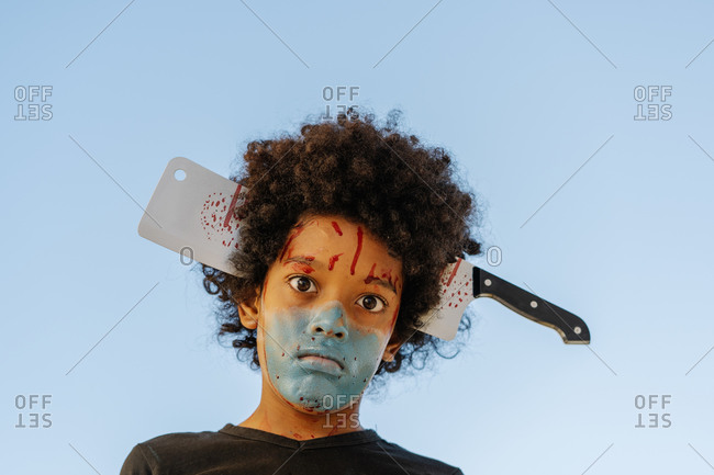 Portrait of an African-American boy with his face painted for the Halloween party