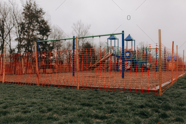 Playground surrounded by temporary fence to keep people away during the Covid-19 pandemic