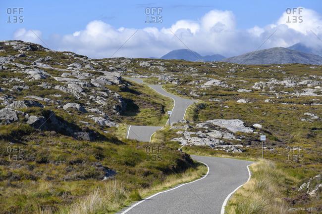 UK- Scotland- Golden Road stretching along southeast coast of Isle of Harris