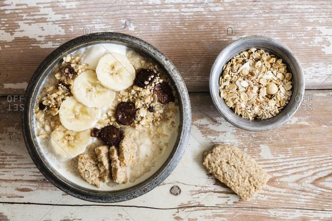 Bowl of banana porridge and oats, top view