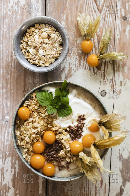 Bowl of porridge with oats- flax seed and winter cherries
