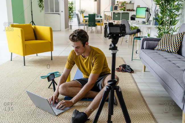 Fitness trainer making arrangement for live streaming while sitting at home