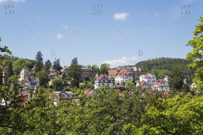 Germany- Thuringia- Eisenach- Historical villas surrounded by green forested hills in spring