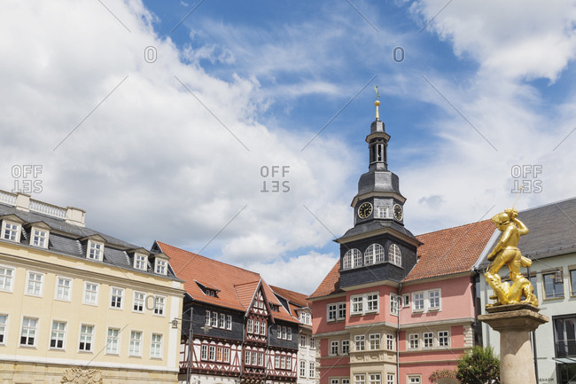 May 30, 2020: Germany- Thuringia- Eisenach- Gold colored Georgsbrunnen fountain statue and historical town hall