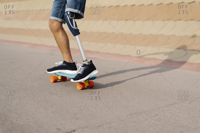 Disabled athlete skateboarding at sports court