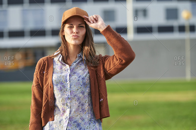Young woman doing pout while standing on street in city
