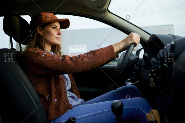 Young woman driving car in city
