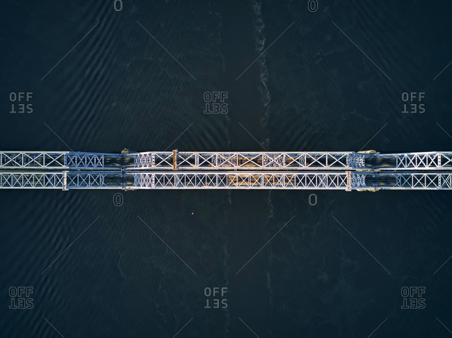 Directly above aerial view of metallic railway bridge over Volga River