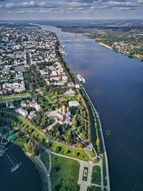 Aerial view of Volga River by cityscape against cloudy sky