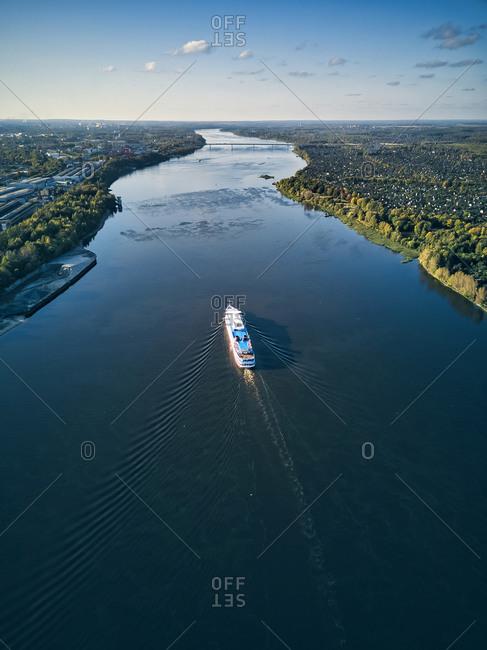 Ship moving along Volga River against sky