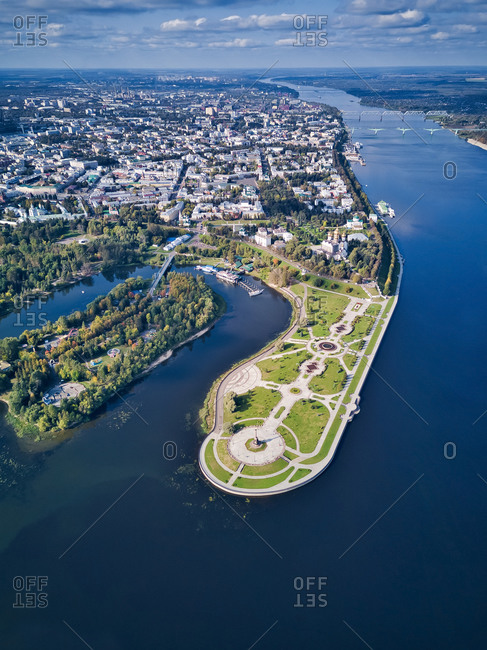 Aerial view of park by city amidst Volga River and Kotorosl River on sunny day