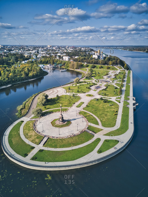 Park near city with Volga River and Kotorosl River against sky on sunny day