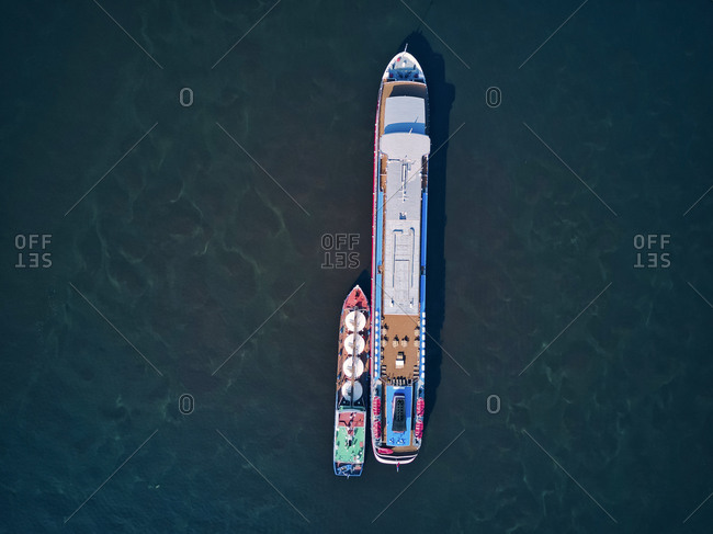 September 24, 2020: Barge refueling recreational boat on Volga River
