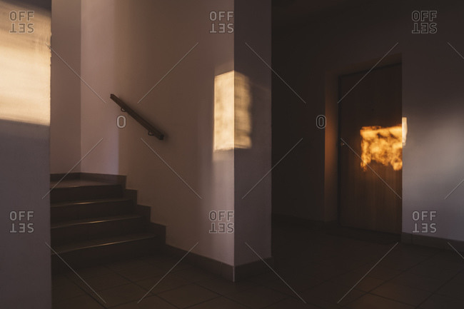 Sunlight on wall and door in building