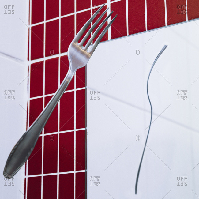Fork in mid-air reflecting on mirror