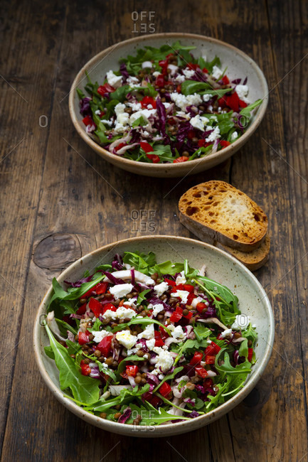 Two bowls of vegetable salad with lentils- arugula- red bell pepper- feta cheese andradicchio