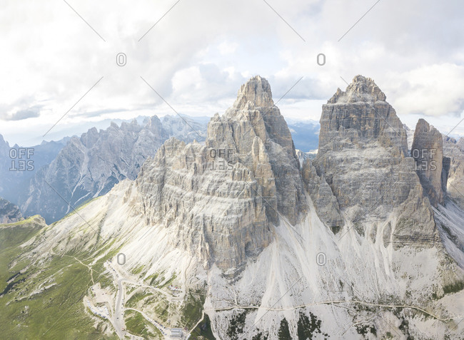 Drone view of rocky mountain peaks against cloudy sky- Sesto Dolomites- Dolomites- Alto Adige- Italy