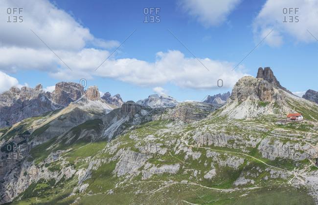 Hut at famous Tre Cime di Lavaredo against sky on sunny day- Sesto Dolomites- Dolomites- Alto Adige- Italy