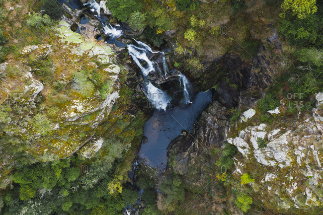 Drone view of famous Fervenza do Toxa through rocks in forest- Pontevedra Province- Galicia- Spain