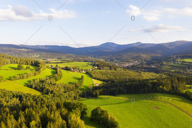 Drone view of Lamer Winkel valley in summer with Kleiner Arber and Grosser Arber mountains in distant background