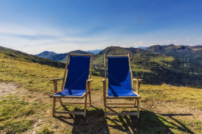 Folding chair on mountain against clear sky at Turracher Hoehe- Gurktal Alps- Austria