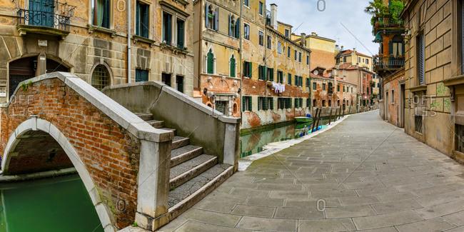 April 4, 2019: Italy- Veneto- Venice- Short arch bridge over old town canal
