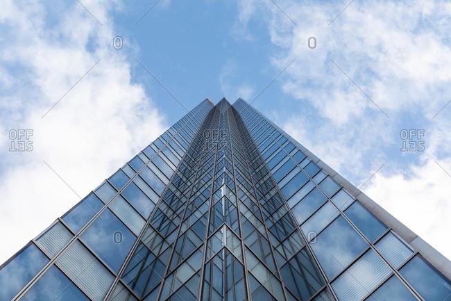 Tall modern office glass skyscraper against blue sky- London- UK