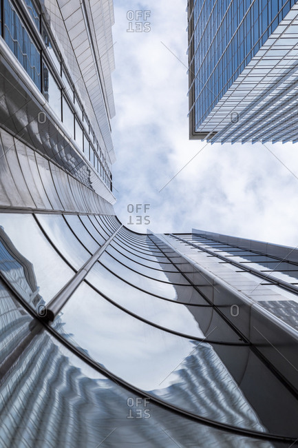 Reflection on tall modern office skyscraper at downtown against sky- London- UK