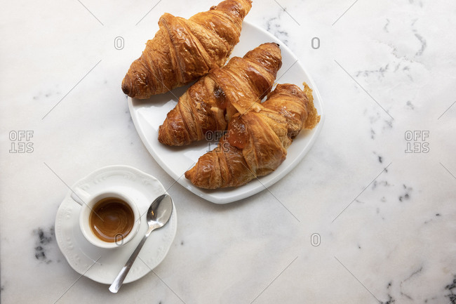 Top view of croissants and a cup of espresso