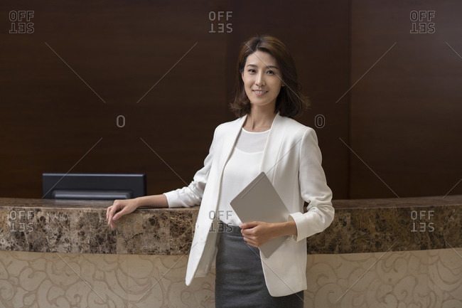 Chinese hotel manager in hotel lobby