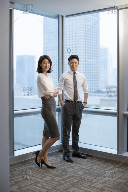 Confident Chinese business people in office