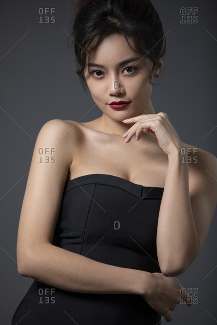 Beautiful young Chinese woman in black dress