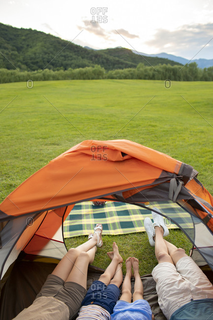 Young Chinese family camping outdoors