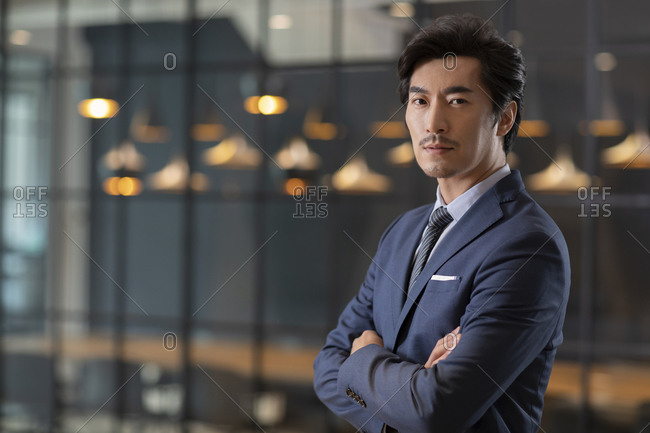 Successful Chinese businessman with his arms crossed