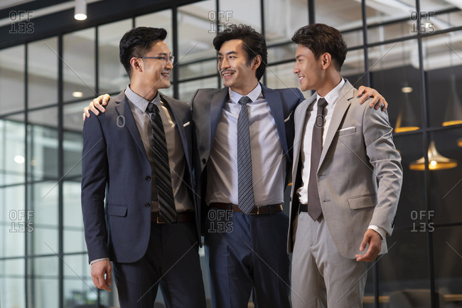Successful Chinese businessmen talking in office
