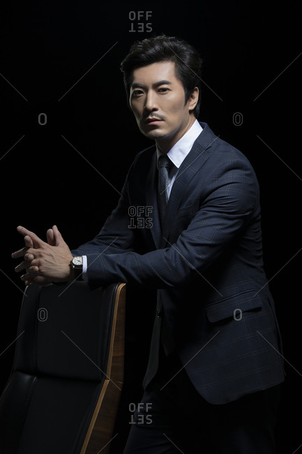 Successful Chinese businessman with his hands together