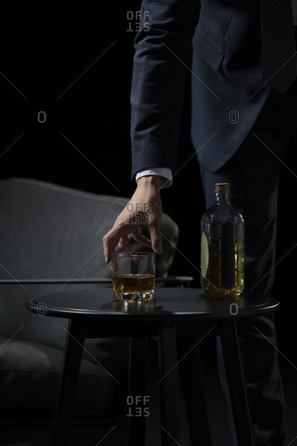Successful Chinese businessman tasting whisky