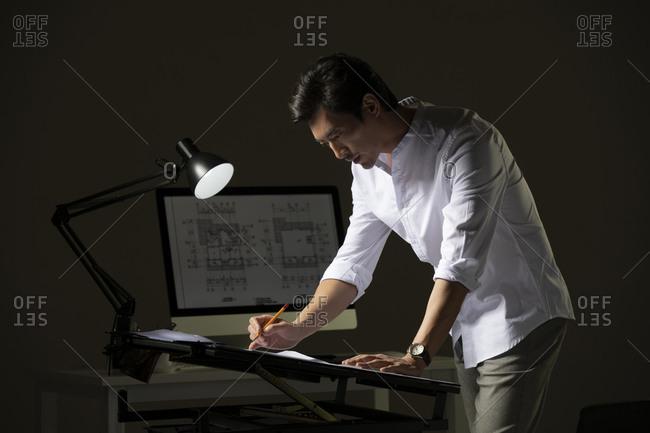 Chinese designer working on construction plan