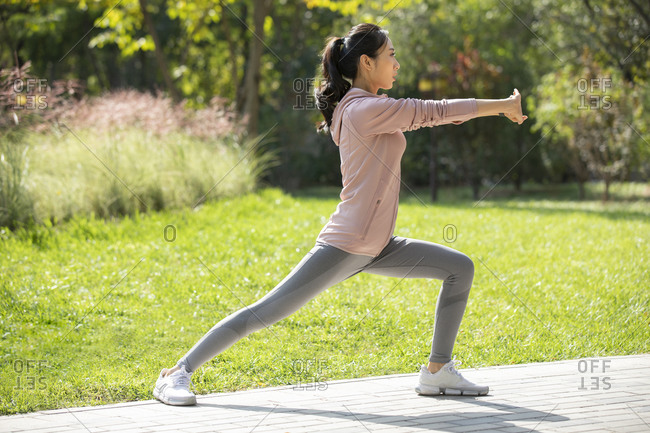 Young Chinese woman exercising in park
