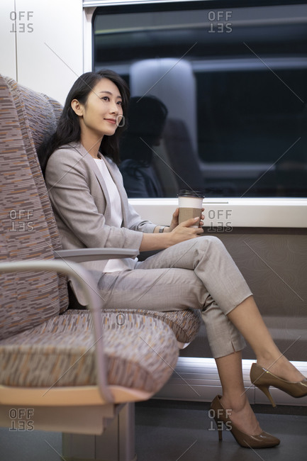 Young Chinese businesswoman on high-speed train