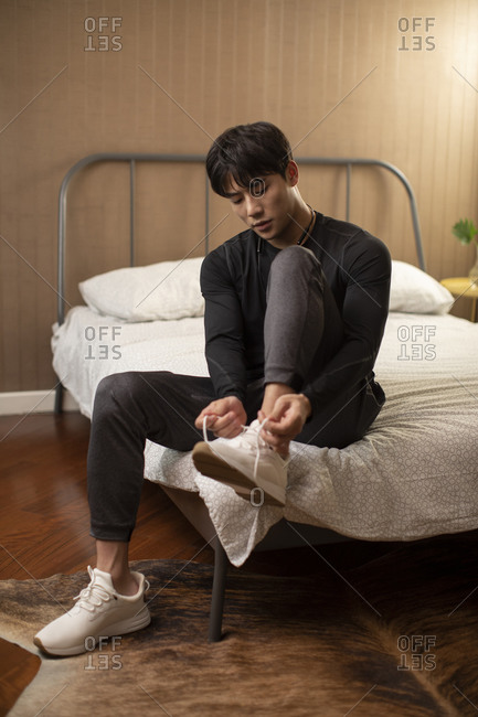 Young Chinese man getting up for morning exercises